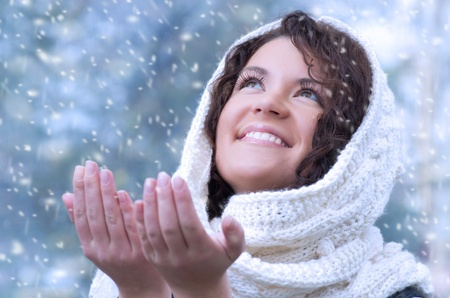 Pretty young caucasian brunette woman wearing white scarf with hood in a outdoor winter portrait  Stock Photo - 10815644