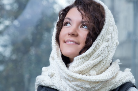 Pretty young caucasian brunette woman wearing white scarf with hood in a outdoor winter portrait Stock Photo - 10809119