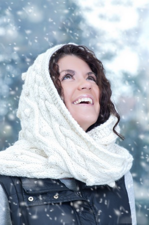 Pretty young caucasian brunette woman wearing white scarf with hood in a outdoor winter portrait Stock Photo - 10815634