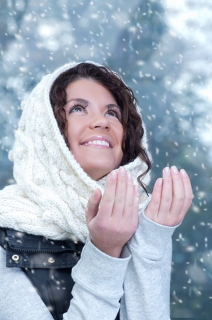 Pretty young caucasian brunette woman wearing white scarf with hood in a outdoor winter portrait Stock Photo - 10815638