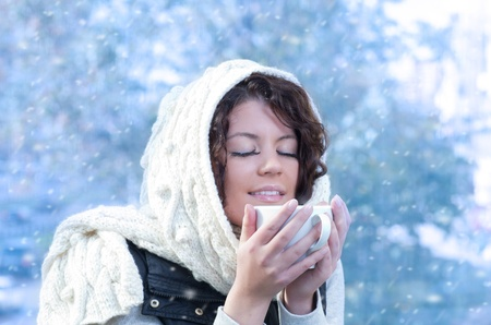 Pretty young caucasian brunette woman wearing white scarf with hood in a outdoor winter portrait Stock Photo - 10815633