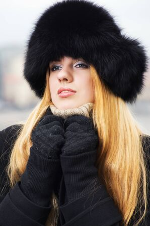 Young caucasian beautiful  redhead  woman against urban background. Stock Photo - 11199064