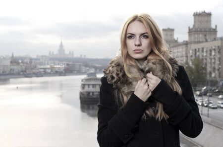 Young caucasian beautiful  redhead  woman against urban background. Stock Photo - 11199025