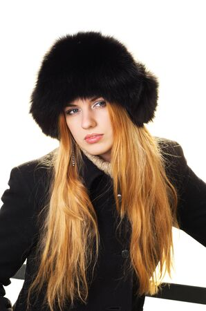 Young caucasian beautiful  redhead  woman wearing fur hat. Isolated on white background. photo