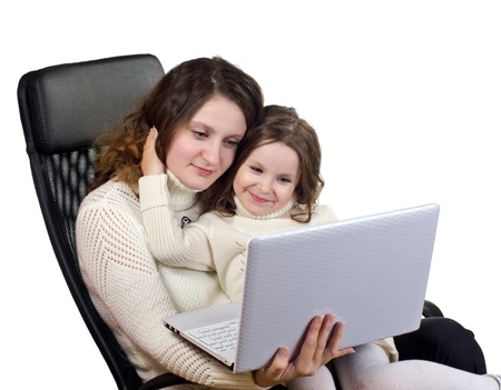 Studio portrait of beautiful little girl and her mother sitting on black leather armchair with laptop. Isolated on white background. Stock Photo - 11958937