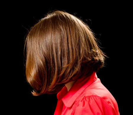 Beautiful caucasian woman with fashion bob haircut. Isolated on black background. Stock Photo