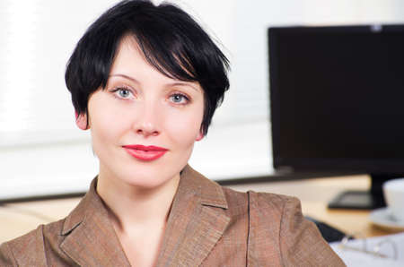 Beautiful caucasian brunette businesswoman in her office. Stock Photo - 12128344