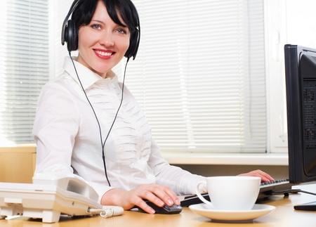 Beautiful caucasian brunette businesswoman in her office.