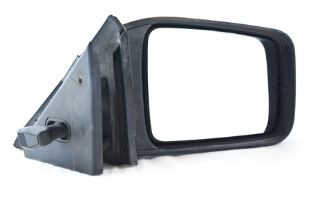 Used side rear view mirror. Isolated on white background.