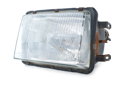lugs: Used headlamp as repair part. Isolated on white background. Stock Photo