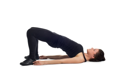 Attractive young caucasian brunette woman while abdominal training on the floor  Isolated on white background  Stock Photo