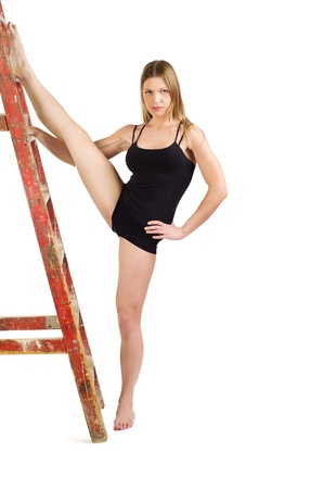 twine: Beautiful caucasian blonde fitness woman doing stretching exercise with ladder  Isolated over white background