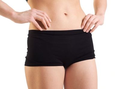 Cropped image of a female body with arms touching the abdomen   Isolated on white background  Stock Photo