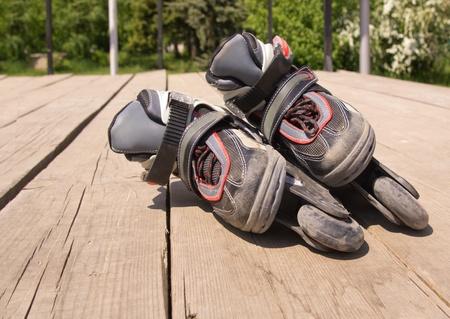 Kid`s inline rollerblade against urban background. photo