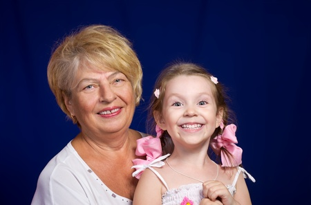 Lovely little girl with her grandmother looking at the camera photo
