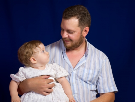 Portrait Of Father With Baby Daughter At Studio Stock Photo