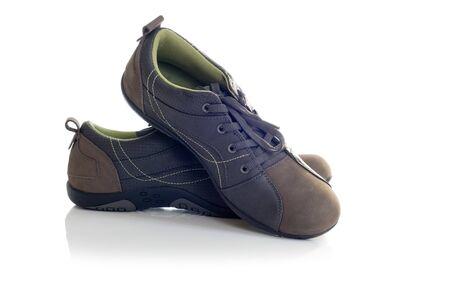 Female sport leather shoes  Isolated on white background  photo