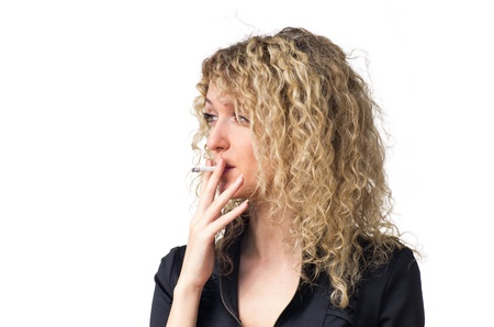 black girl smoking: Attractive young business woman with curly hair smoking sigarette. Isolated against white background.
