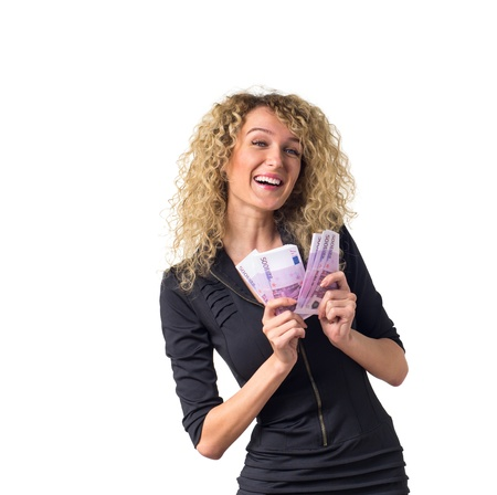 Attractive young business woman with curly hair counts money,  laughing. Isolated against white background.