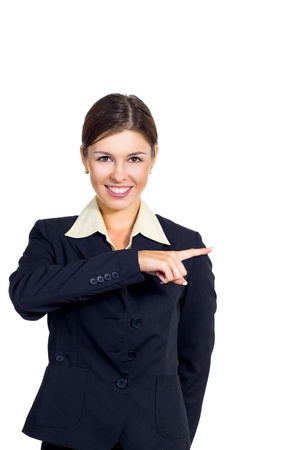Attractive young brunette businesswoman shows the direction to right. Isolated against white background.