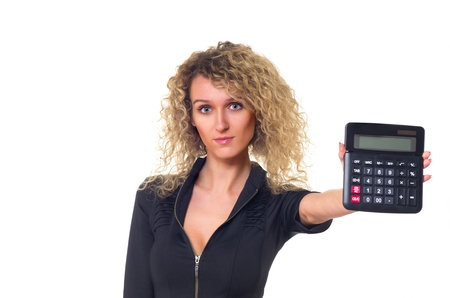Attractive young business woman with curly hair shows calculator in her hand. Isolated against white background. photo