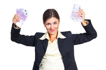 sums: Attractive young brunette businesswoman enjoys receiving large sums of money. Isolated against white background. Stock Photo