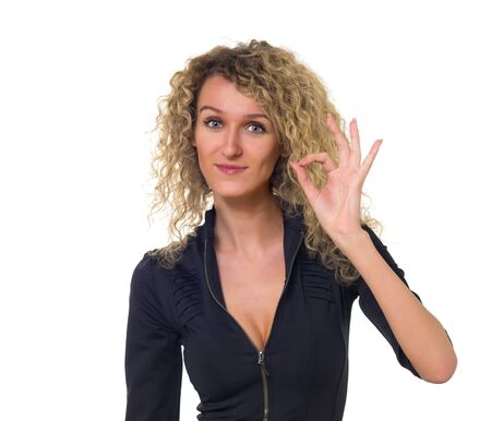 Attractive young business woman with curly hair shows sign 'ok'. Isolated against white background. photo