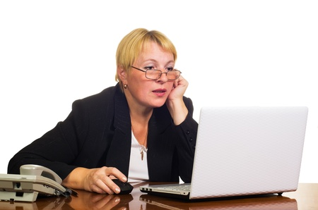 Mature businesswoman working with laptop on her workplace  Isolated against white background