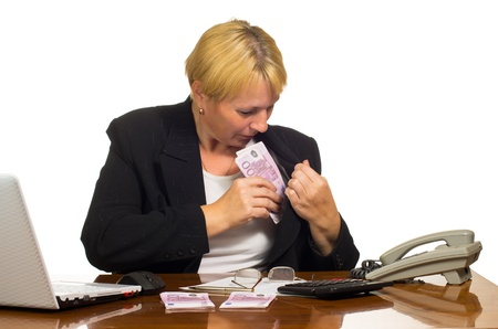 Mature businesswoman hides money  Isolated against white background  Stock Photo
