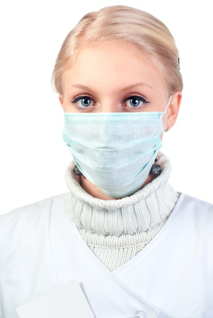 A doctor wearing a mask on white background photo
