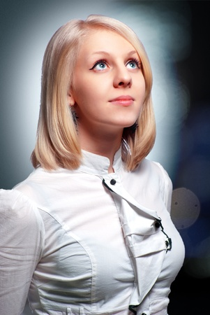 Beautiful caucasian businesswoman looking up  photo