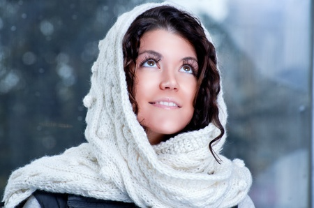 Pretty young caucasian brunette woman wearing white scarf with hood in a outdoor winter portrait Stock Photo - 16304909