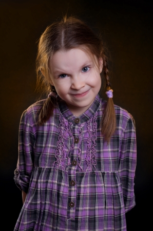 Little girl dressed in a plaid dress