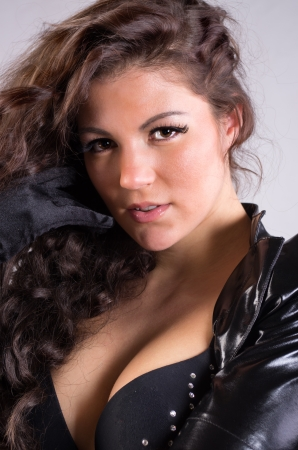 Portrait of young attractive woman in leather jacket