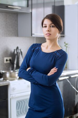 helthcare: Portrait of young attractive caucasian brunette housewife at kitchen. Stock Photo