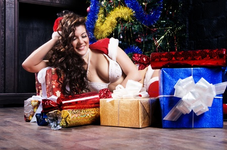 Beautiful brunette wearing sexy posing over christmas background photo