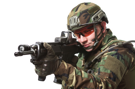 NATO soldier in full gear  Military man isolated over white background