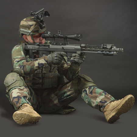 soldier in full gear. Military man over black background. photo
