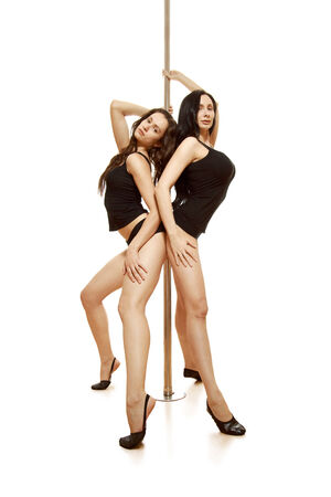 Two sexy girls. Isolated against white background. photo