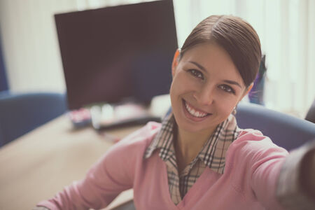 Portrait Of Young Caucasian Business Woman In Suit Doing Selfie