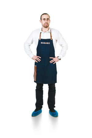 arms akimbo: A shoot of young caucasian men in apron as a barmen with arms akimbo. Isolated against white background.