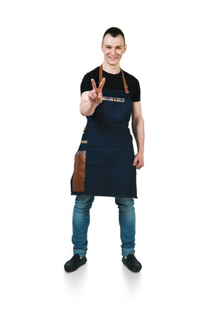 barmen: A shoot of young caucasian men in apron as a barmen. Showing the sign victory, two fingers up,