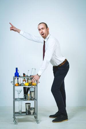 barmen: A shoot of young caucasian men as a barmen doing a cocktail.