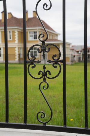 decorative element: Ornamented iron fence element vintage look abstract metal pattern Stock Photo