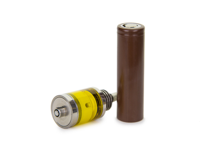 atomizer: Vaping parts. Atomizer with brown battery. Isolated over white background.
