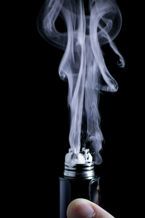 background e cigarette: E-cigarette vape. Isolated against black background.