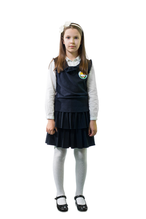 Schoolgirl in uniform against white background.