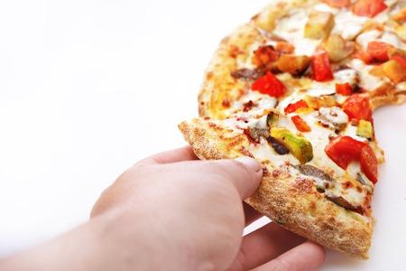 Male hand picking tasty pizza slice, white background