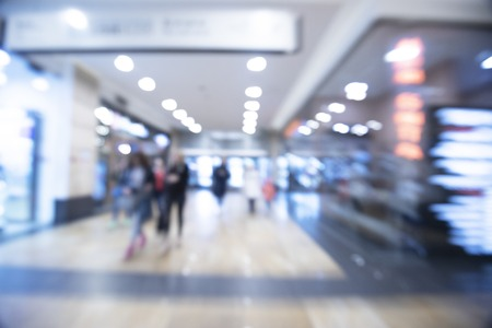 Abstract blurred image of shopping mall and people for background usage