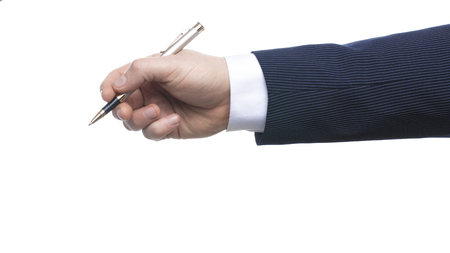 A hand pen top view writing on white background